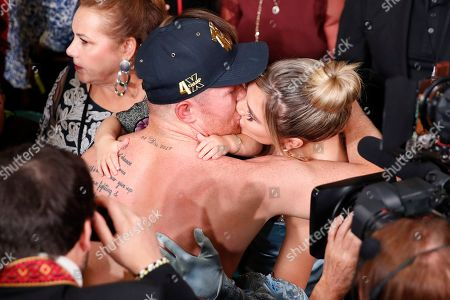 Canelo Alvarez kisses his wife, Shannon de Lima, after defeating Sergey Kovalev by knockout in a light heavyweight WBO title bout, in Las Vegas