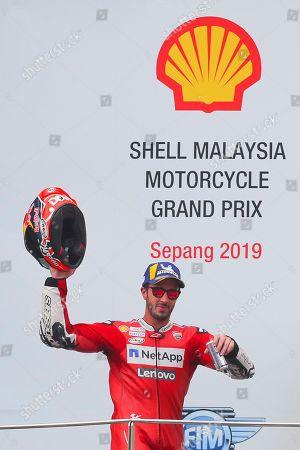 Third-place winner Italian MotoGP rider Andrea Dovizioso of Ducati team celebrates on the podium at the Motorcycling Grand Prix of Malaysia 2019 in Sepang International Circuit, outside Kuala Lumpur, Malaysia, 03 November 2019.