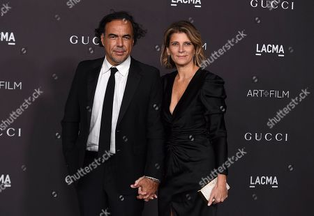 Stock Image of Alejandro Gonzalez Inarritu, Maria Eladia. Alejandro Gonzalez Inarritu and Maria Eladia arrive at the 2019 LACMA Art and Film Gala at Los Angeles County Museum of Art, in Los Angeles