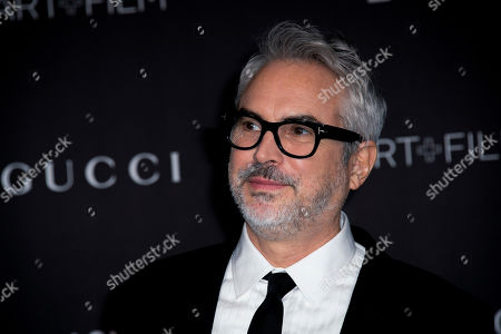 Mexican director Alfonso Cuaron poses upon his arrival at the 2019 LACMA Art + Film Gala at the Los Angeles County Museum of Art in Los Angeles, California, USA, 02 November 2019.