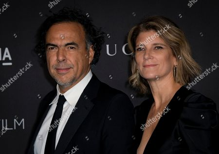 Mexican director Alejandro Gonzalez Inarritu (L) and his wife, Maria Eladia Hagerman (R), pose upon their arrival at the 2019 LACMA Art + Film Gala at the Los Angeles County Museum of Art in Los Angeles, California, USA, 02 November 2019.