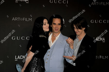 Australian musician Nick Cave (C), his wife Susie Bick (L) and their son Earl Cave (R), pose upon their arrival at the 2019 LACMA Art + Film Gala at the Los Angeles County Museum of Art in Los Angeles, California, USA, 02 November 2019.