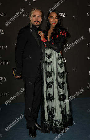 US actress Zoe Saldana (R) and her husband, Italian artist Marco Perego (L), pose upon their arrival at the 2019 LACMA Art + Film Gala at the Los Angeles County Museum of Art in Los Angeles, California, USA, 02 November 2019.
