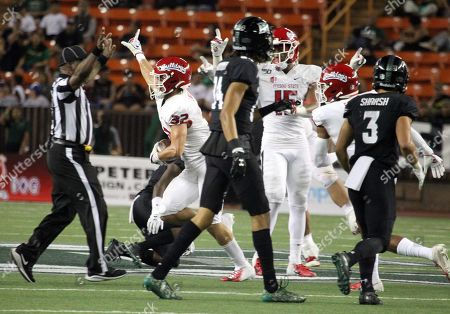 Stock Image of Fresno State Bulldogs defensive back Evan Williams #32 celebrates an interception during a game between the Fresno State Bulldogs and the Hawaii Rainbow Warriors at Aloha Stadium in Honolulu, HI - Michael Sullivan/CSM
