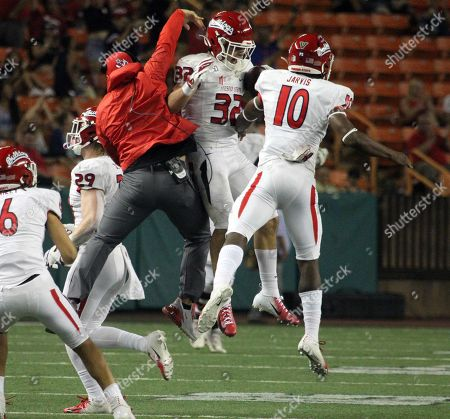 Stock Picture of Fresno State Bulldogs defensive back Evan Williams #32 celebrates an interception during a game between the Fresno State Bulldogs and the Hawaii Rainbow Warriors at Aloha Stadium in Honolulu, HI - Michael Sullivan/CSM