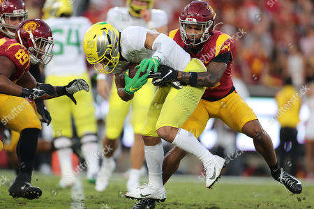 USC Trojans safety Isaiah Pola-Mao (21) stops Oregon Ducks wide receiver Mycah Pittman (4) USC Trojans defensive lineman Christian Rector (89) comes up for support during the game between the Oregon Ducks and the USC Trojans at the Los Angeles Memorial Coliseum