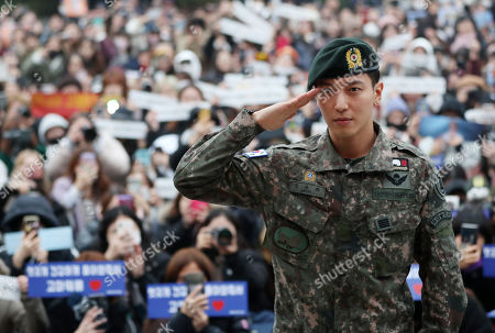 Stock Image of Jung Yong-hwa, a member of K-pop boy band CNBLUE, salutes after being discharged from military service at an Army base in Chuncheon, Gangwon Province, South Korea, 03 November 2019.
