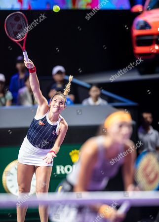 Timea Babos of Hungary (L) and Kristina Mladenovic of France (R) react during their final match against Su Wei Hsieh of Chinese Taipei and Barbora Strycova of Czech Republic at the WTA Finales 2019 tournament doubles finales match in Shenzhen, China, 03 November 2019.