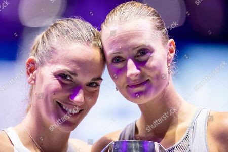 Timea Babos of Hungary (L) and Kristina Mladenovic of France (R) receives their trophy after winning the women's doubles final match against  Su Wei Hsieh of Chinese Taipei and Barbora Strycova of Czech Republic at the WTA Finales 2019 tournament doubles finales match in Shenzhen, China, 03 November 2019.