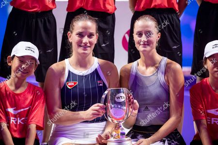 Timea Babos of Hungary (L) and Kristina Mladenovic of France (R) receive their trophy after winning the women's doubles final match against  Su Wei Hsieh of Chinese Taipei and Barbora Strycova of Czech Republic at the WTA Finales 2019 tournament doubles finales match in Shenzhen, China, 03 November 2019.