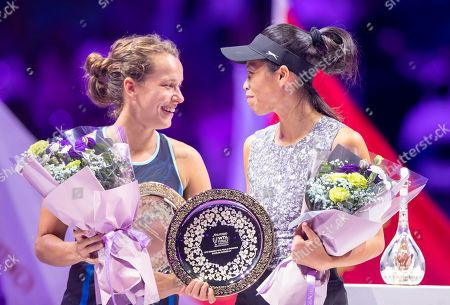 Su Wei Hsieh of Chinese Taipei (R) and Barbora Strycova of Czech Republic (L) receives their trophy after losing the women's singles final match against Timea Babos of Hungary and Kristina Mladenovic of France at the WTA Finales 2019 tournament doubles finales match in Shenzhen, China, 03 November 2019.
