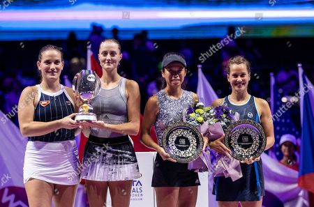 (L-R) Timea Babos of Hungary and Kristina Mladenovic of France  posing for pictures with  their trophy after winning the women's doubles final match against  Su Wei Hsieh of Chinese Taipei and Barbora Strycova of Czech Republic at the WTA Finales 2019 tournament doubles finales match in Shenzhen, China, 03 November 2019.