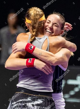 Timea Babos of Hungary (R) and Kristina Mladenovic of France (L) celebrate winning against Su Wei Hsieh of Chinese Taipei and Barbora Strycova of Czech Republic at the WTA Finales 2019 tournament doubles finales match in Shenzhen, China, 03 November 2019.