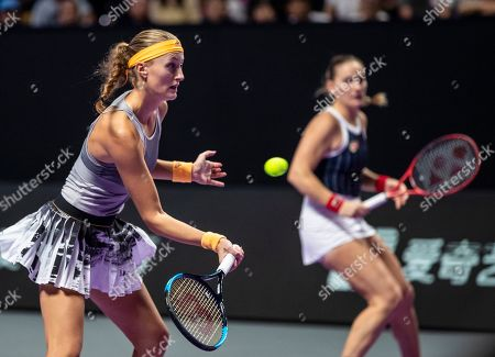 Stock Image of Timea Babos of Hungary (R) and Kristina Mladenovic of France (L) in action against Su Wei Hsieh of Chinese Taipei and Barbora Strycova of Czech Republic at the WTA Finales 2019 tournament doubles final match in Shenzhen, China, 03 November 2019.