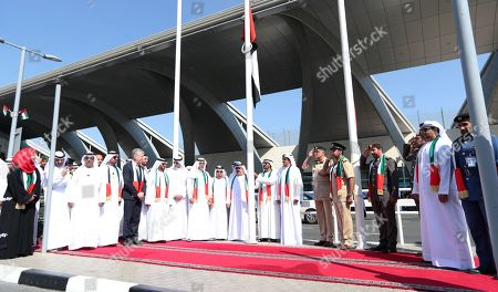 His Highness Sheikh Ahmed Bin Saeed Al Maktoum (C), President of Dubai Civil Aviation Authority, Chairman of Dubai Airports and Chairman and Chief Executive of Emirates Airline and Group, raises the UAE flag during celebration of UAE Flag Day in front of Dubai International Airport in Dubai, United Arab Emirates, 03 November 2019. The Flag Day is marked to celebrate the national unity for the seven emirates in 1971. It marks the day when Sheikh Khalifa bin Zayed Al Nahyan was elected as the new President of the United Arab Emirates on 03 November 2004 after the death of his father, Sheikh Zayed .