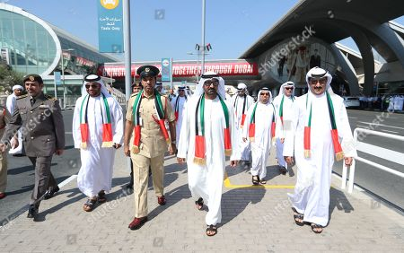 His Highness Sheikh Ahmed Bin Saeed Al Maktoum (4-L), President of Dubai Civil Aviation Authority, Chairman of Dubai Airports and Chairman and Chief Executive of Emirates Airline and Group, arrives to attend the celebration of UAE Flag Day in front of Dubai International Airport in Dubai, United Arab Emirates, 03 November 2019. The Flag Day is marked to celebrate the national unity for the seven emirates in 1971. It marks the day when Sheikh Khalifa bin Zayed Al Nahyan was elected as the new President of the United Arab Emirates on 03 November 2004 after the death of his father, Sheikh Zayed.