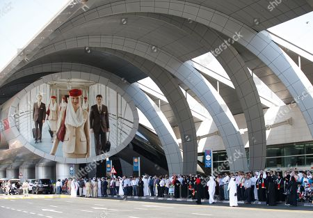 People take part in front of Dubai International Airport during UAE Flag Day in Gulf emirate of Dubai, United Arab Emirates, 03 November 2019. The Flag Day is marked to celebrate the national unity for the seven emirates in 1971. It marks the day when Sheikh Khalifa bin Zayed Al Nahyan was elected as the new President of the United Arab Emirates on 03 November 2004 after the death of his father, Sheikh Zayed.