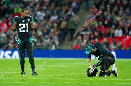 Stock Image of Jacksonville Jaguars Defensive Back A. J. Bouye receives a repair to his helmet