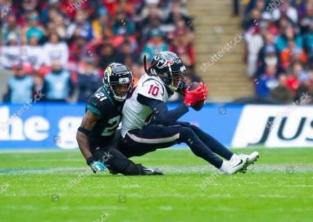 Houston Texans Wide Receiver DeAndre Hopkins is tackled by Jacksonville Jaguars Defensive Back A. J. Bouye
