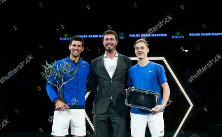 Novak Djokovic of Serbia, left, poses with Russian former tennis player Marat Safin, center, and Denis Shapovalov of Canada after winning the final match of the Paris Masters tennis tournament in Paris, . Djokovic defeated Shapovalov 6-3/6-4