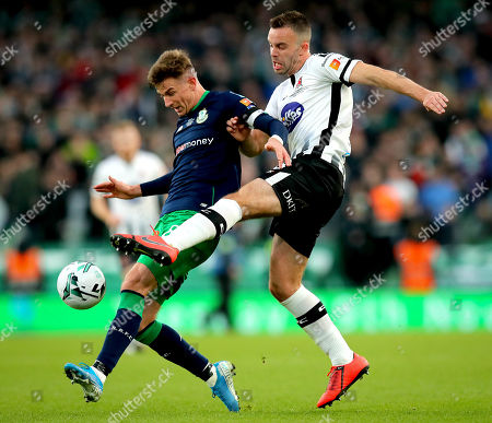 Dundalk vs Shamrock Rovers. Dundalk's Robbie Benson and Ronan Finn of Rovers