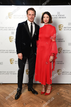 Stock Image of Exclusive - Director Fiction - Jon S Baird, presenters Sam Heughan and Caitriona Balfe