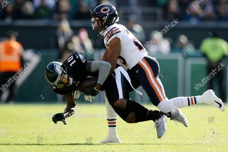 Philadelphia Eagles' DeSean Jackson, left, is tackled by Chicago Bears' Kyle Fuller during the first half of an NFL football game, in Philadelphia