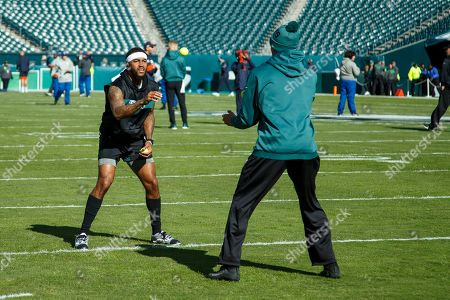 Philadelphia Eagles wide receiver DeSean Jackson, left, runs a tennis ball drill with Mack Hollins, right, prior to the the NFL football game against the Chicago Bears, in Philadelphia. The Eagles won 22-14