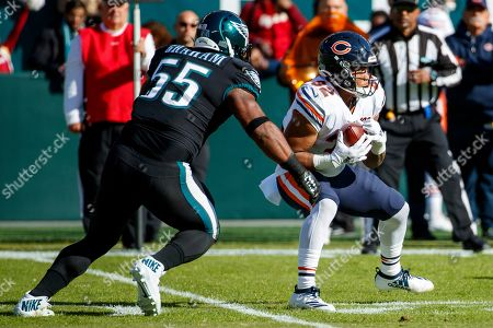 Chicago Bears running back David Montgomery (32) in action against Philadelphia Eagles defensive end Brandon Graham (55) during the the NFL football game, in Philadelphia. The Eagles won 22-14