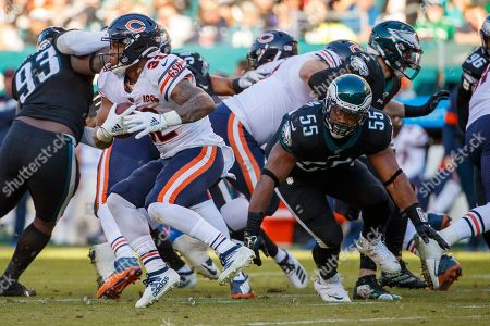 Chicago Bears running back David Montgomery (32) runs with the ball as he gets past Philadelphia Eagles defensive end Brandon Graham (55) during the the NFL football game, in Philadelphia. The Eagles won 22-14