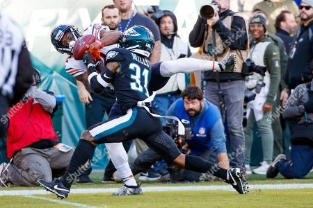 Stock Picture of Chicago Bears wide receiver Allen Robinson (12) goes up for the pass against Philadelphia Eagles cornerback Jalen Mills (31), but will not complete it, during the the NFL football game, in Philadelphia. The Eagles won 22-14