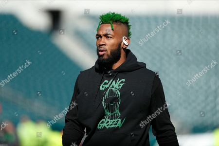 Philadelphia Eagles' Jalen Mills warms up before an NFL football game against the Chicago Bears, in Philadelphia