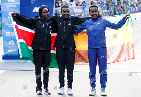 Stock Picture of First place finisher Joyciline Jepkosgei of Kenya (C) poses with second place finisher Mary Keitany of Kenya (L) and third place Ruti Aga of Ethiopia (R) at the finish line after winning the women?s division of the 2019 TCS New York City Marathon in New York, New York, USA, 03 November 2019.