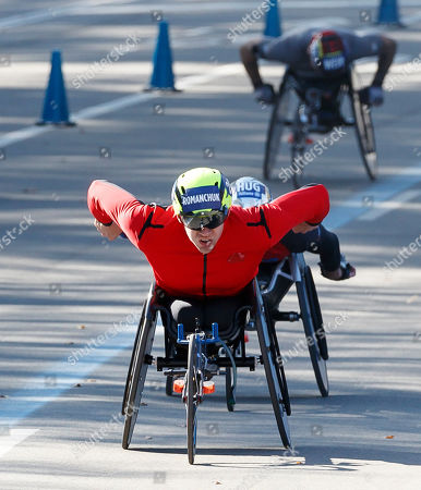 Stock Photo of Daniel Romanchuk of the US finishes in first place in the men?s wheelchair division of 2019 TCS New York City Marathon in New York, New York, USA, 03 November 2019. Finishing in second place was Marcel Hug of Switzerland (2-L, obscured) and in third place was David Weir of the United Kingdom (R).