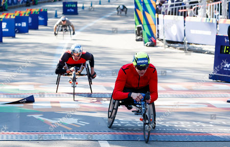 Daniel Romanchuk (R) of the US finishes in first place in the men?s wheelchair division of 2019 TCS New York City Marathon in New York, New York, USA, 03 November 2019. Finishing in second place was Marcel Hug (C) of Switzerland and in third place was David Weir (L) of the United Kingdom.
