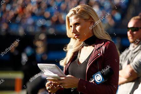 CBS reporter Melanie Collins watches from the sidelines during the second half of an NFL football game between the Carolina Panthers and the Tennessee Titans in Charlotte, N.C