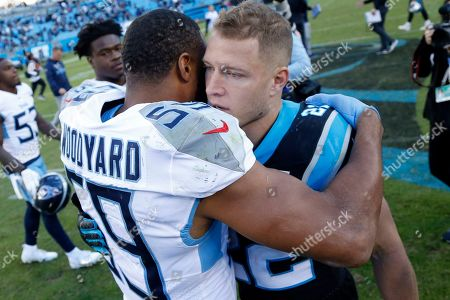 Carolina Panthers running back Christian McCaffrey, right, and Tennessee Titans inside linebacker Wesley Woodyard (59) speak following an NFL football game in Charlotte, N.C