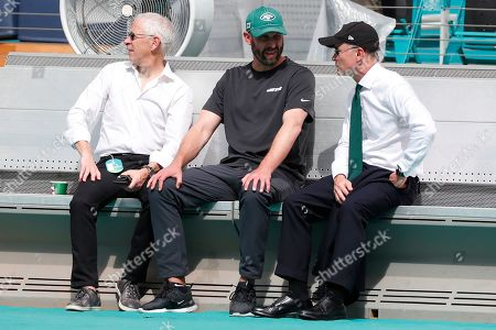 Adam Gase, Woody Johnson. New York Jets head coach Adam Gase, left, talks with New York Jets owner Woody Johnson during practice before an NFL football game, in Miami Gardens, Fla