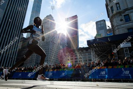 Mary Keitany of Kenya follows the leader of the professional women's division during the New York City Marathon, in New York