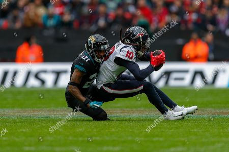 Houston Texans Wide Receiver DeAndre Hopkins (10) Jacksonville Jaguars Defensive Back A. J. Bouye (21) during the International Series match between Jacksonville Jaguars and Houston Texans at Wembley Stadium, London