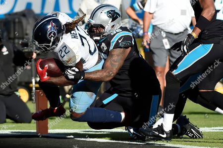Tennessee Titans running back Derrick Henry (22) scores a touchdown while Carolina Panthers defensive tackle Dontari Poe (95) tackles during the second half of an NFL football game in Charlotte, N.C