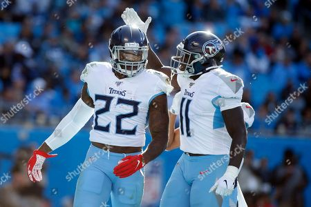 Tennessee Titans wide receiver A.J. Brown (11) congratulates running back Derrick Henry (22) following Henry's touchdown against the Carolina Panthers during the second half of an NFL football game in Charlotte, N.C