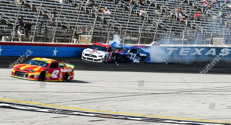 Brad Keselowski (2) and and Ricky Stenhouse Jr. (17) collide during a NASCAR auto race at Texas Motor Speedway, in Fort Worth, Texas