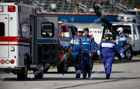 Stock Picture of Ricky Stenhouse Jr., center, is escorted to an ambulance as a precaution after wrecking exiting his vehicle during a NASCAR auto race at Texas Motor Speedway, in Fort Worth, Texas