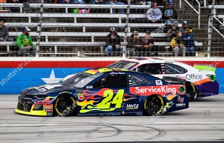 William Byron (24) and Denny Hamlin (11) battle for position during a NASCAR Cup Series auto race at Texas Motor Speedway, in Fort Worth, Texas