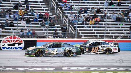 Stock Image of Kevin Harvick (4) and Aric Almirola (10) battle for position during a NASCAR Cup Series auto race at Texas Motor Speedway, in Fort Worth, Texas
