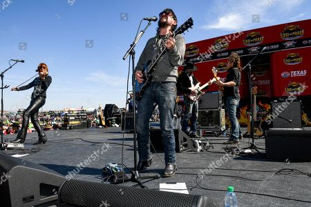 Stock Photo of Shooter Jennings performs before a NASCAR auto race at Texas Motor Speedway, in Fort Worth, Texas