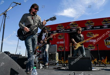 Shooter Jennings, left, performs before a NASCAR auto race at Texas Motor Speedway, in Fort Worth, Texas