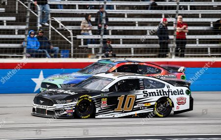 JJ Yeley (53) and Aric Almirola (10) battle for position during a NASCAR Cup Series auto race at Texas Motor Speedway, in Fort Worth, Texas
