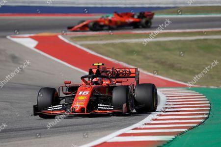Ferrari driver Charles Leclerc, of Monaco, leads over his teammate Ferrari driver Sebastian Vettel, of Germany, during the Formula One U.S. Grand Prix auto race at the Circuit of the Americas, in Austin, Texas